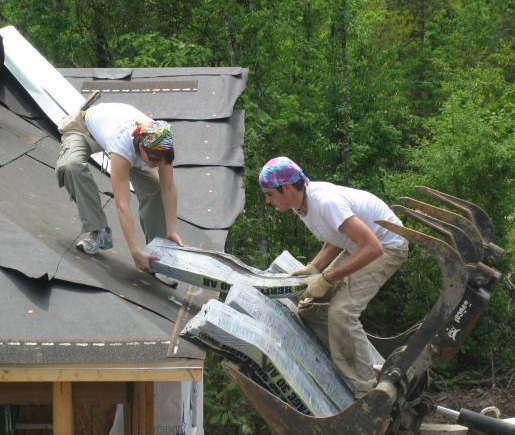Junior Lindsay Peterson and sophomore John Bussey work on a roofing project. (Photo by Riley Karbon)