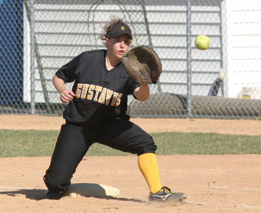 Tina Strauss stretches to make the out at first for the Gusties