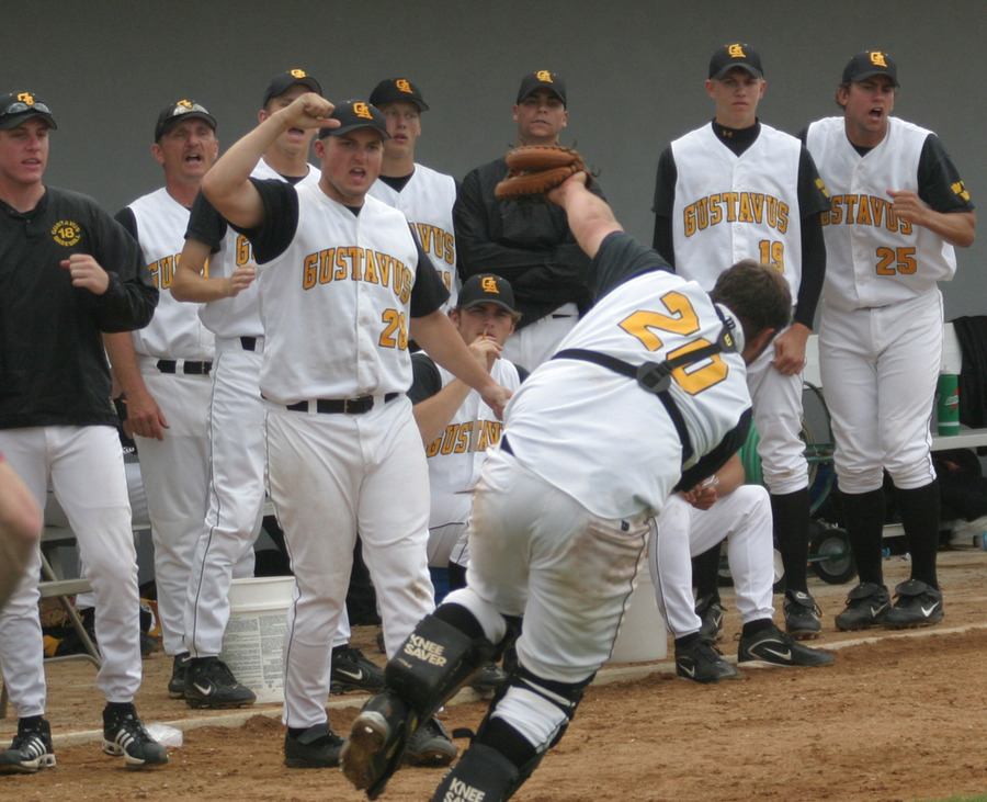 Shea Roehrkasse makes an off-balance play in front of the Gustavus dugout.