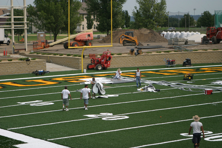 Crew installing the synthetic turf.