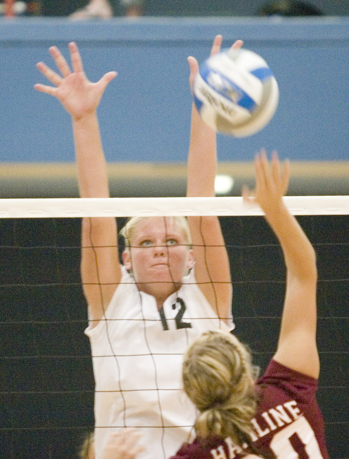 Senior captain Jen Thelemann goes up for a block against Hamline.