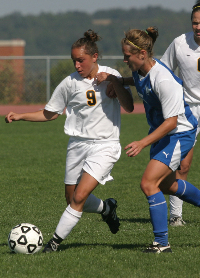 Tami Korb beats a Luther player to the ball.