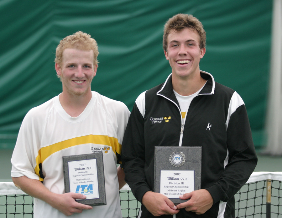 John Kauss and Andy Bryan displays their ITA singles trophies.