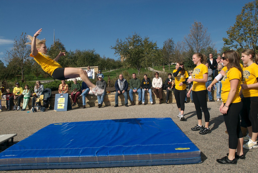 The Gustavus gymnastics team performed during the Homecoming parade. (Photo by Tom Roster)