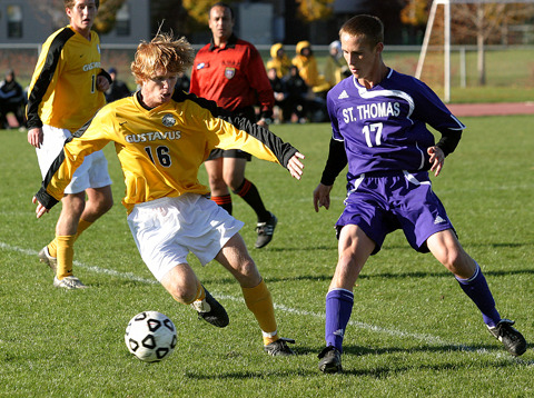 Jack Underwood dribbles the ball at midfield.