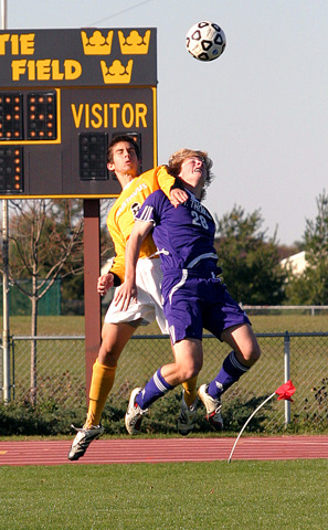 Mike Butterworth and Reid Moser-Bleil jump for the header.
