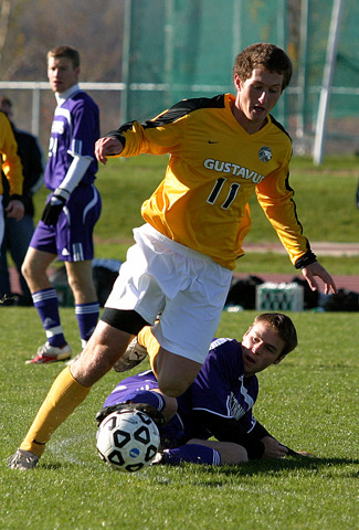 Fraser Horton keeps the ball away from a sliding St. Thomas defender.
