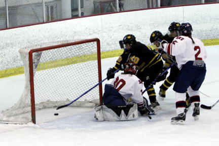 Gustavus players crashed the net against Saint Mary's.