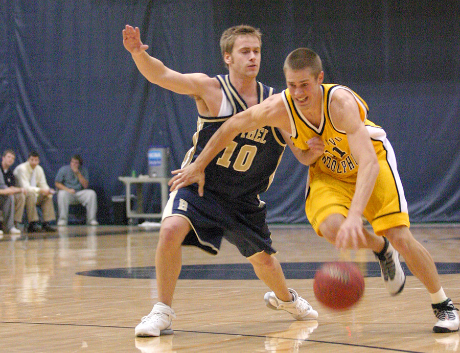 Trevor Wittwer dribbles past a Royal defender.