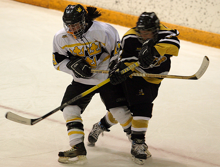 Lisa Sablak fights for positioning with a UW-Superior player.