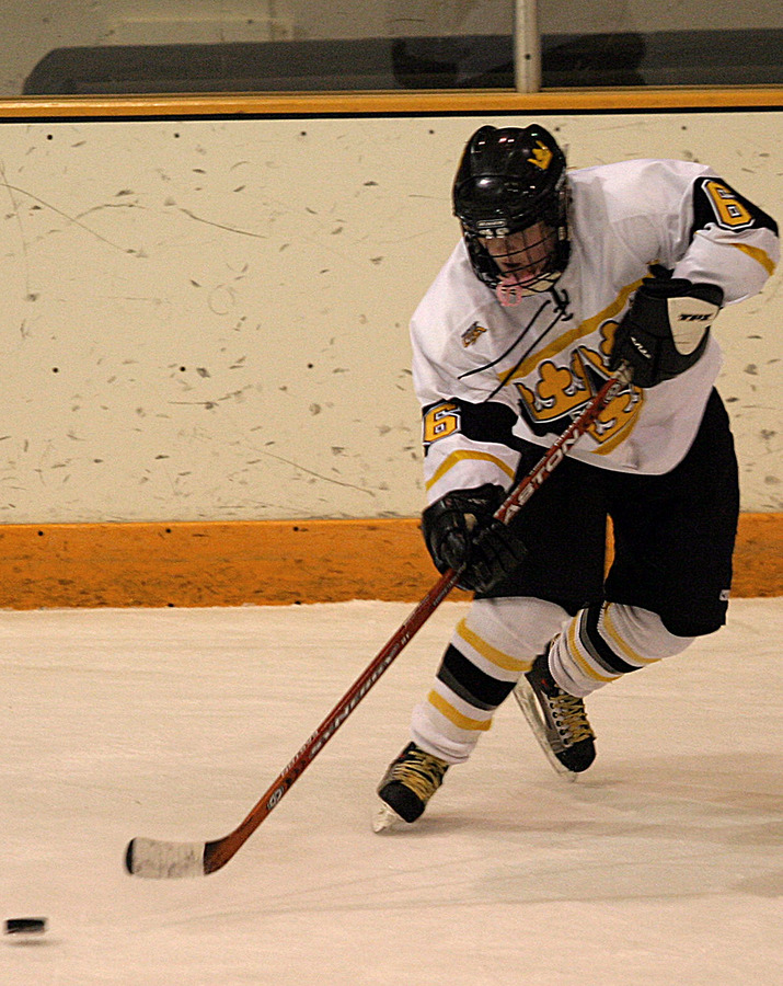 Jenny Pusch passes the puck during a power play.