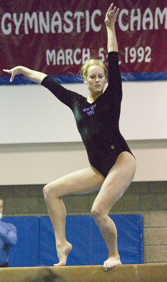Two-time national qualifier Laura Hansen performing on the balance beam.