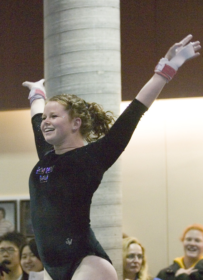 Junior Christine Askham celebrates after a strong bar routine.