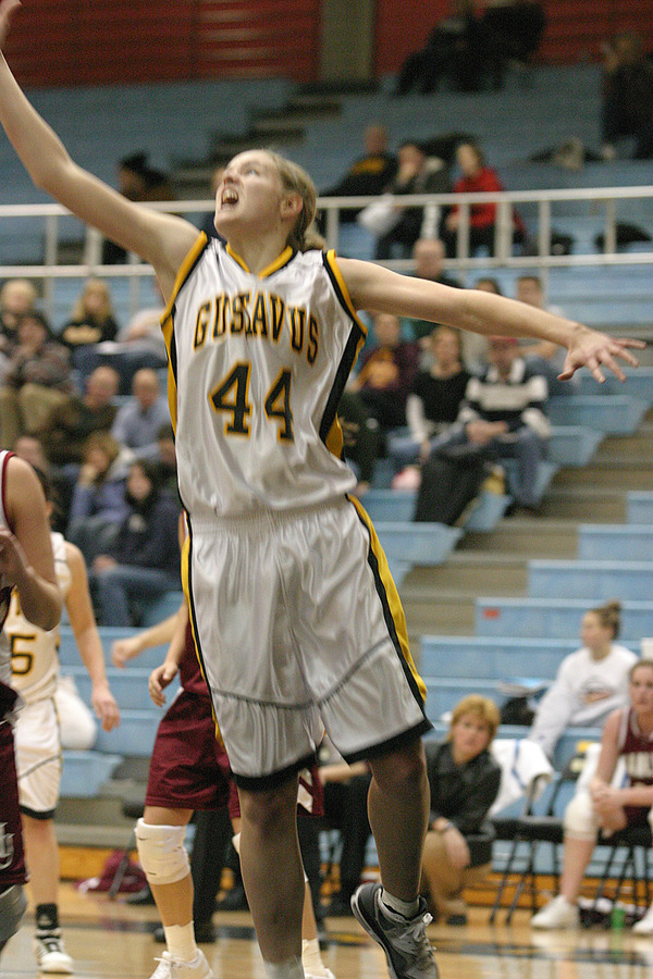 Brittany Holm goes up for a rebound.