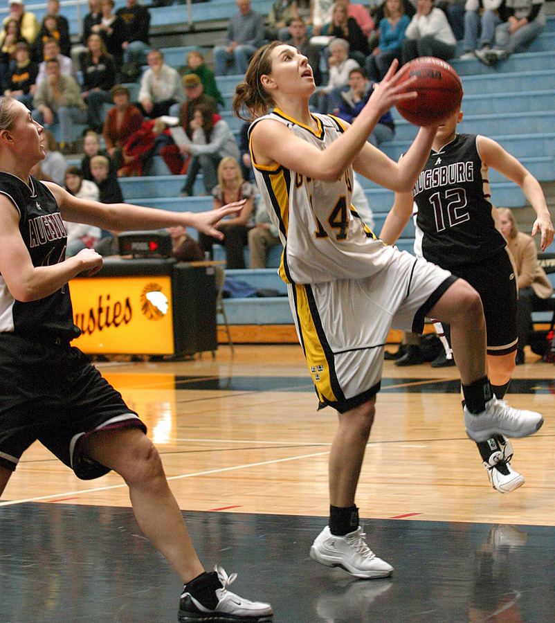 Julia Schultz drives for two of her seven points.