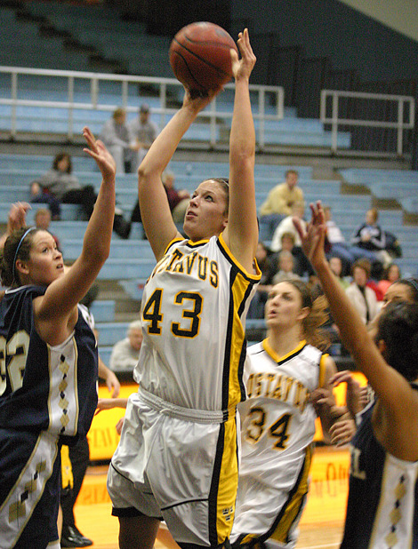 Katy Layman goes  up for two of her 15 points.