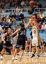 Jess Vadnais hits a three-pointer over Jessica Arechigo.