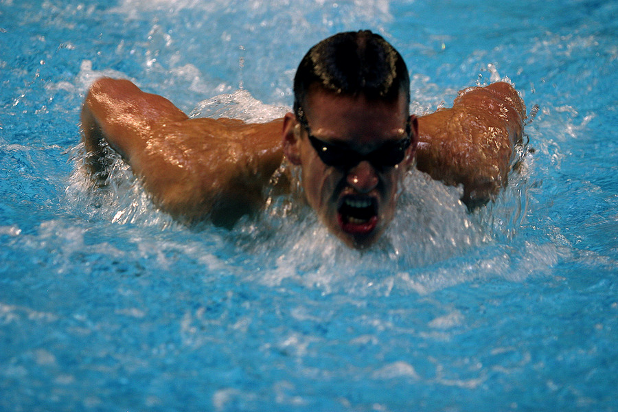 A Gustavus swimmer in the midst of a butterfly stroke