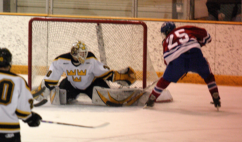 Josh Swartout slides across the crease to make a big save.