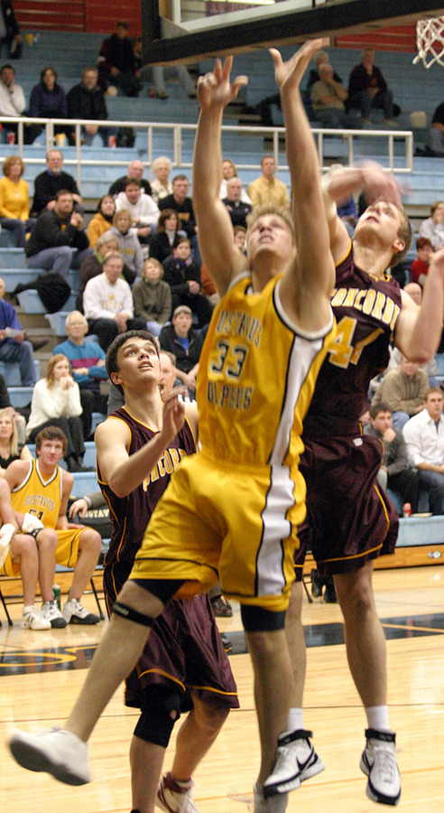Andrew Doble puts up a shot under the basket.