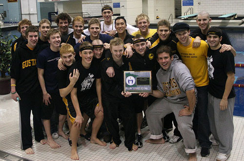 The Gustavus men's team with their first place trophy.  (Photo Courtesy Ryan Coleman, d3sports.com)