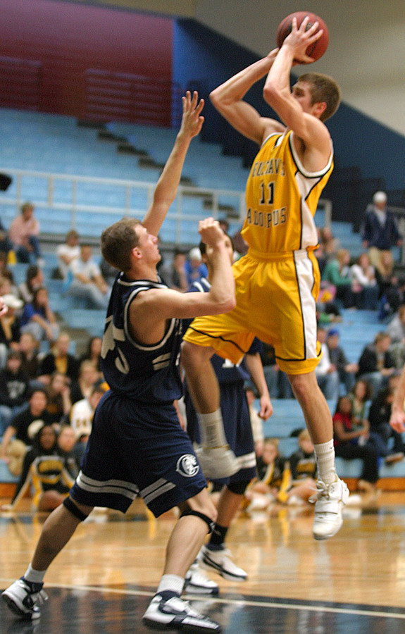 Wittwer goes up for two of his 1,143 career points against Carleton last Saturday.