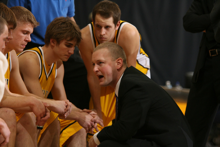 Assistant Coach Josh Drinkall talks defensive strategy during a timeout.  (Bridget Fowler photo)