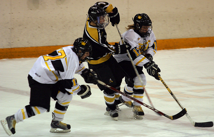 Christine Wicker and Jessica Doig battle for positioning to get to the puck.