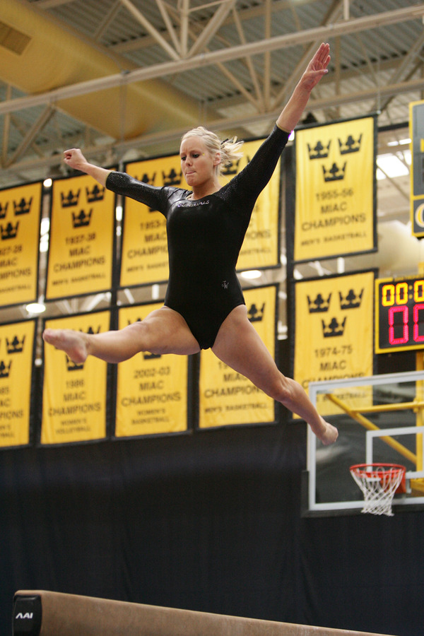 Hansen performing on the balance beam.