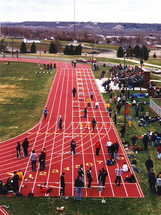 A view of the track being set up for the 110 meter hurdles.