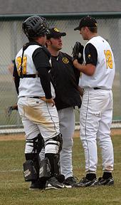 Pitching coach Josh Spitzack talks with pitcher Derek Eddie and catcher Shea Roehrkasse.
