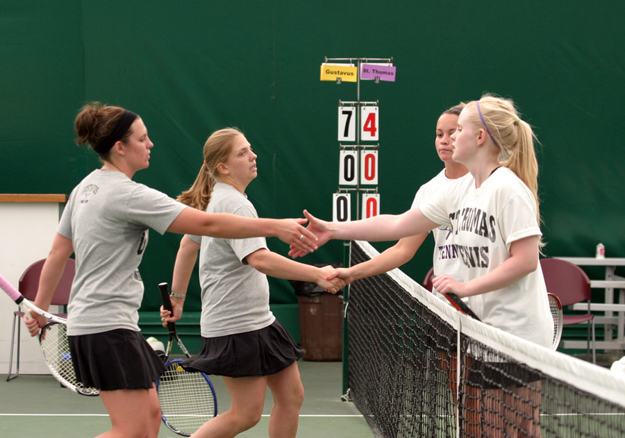 Erica Dobson and Jenny Arnfelt shake hands after winning 8-4 at #3 doubles.