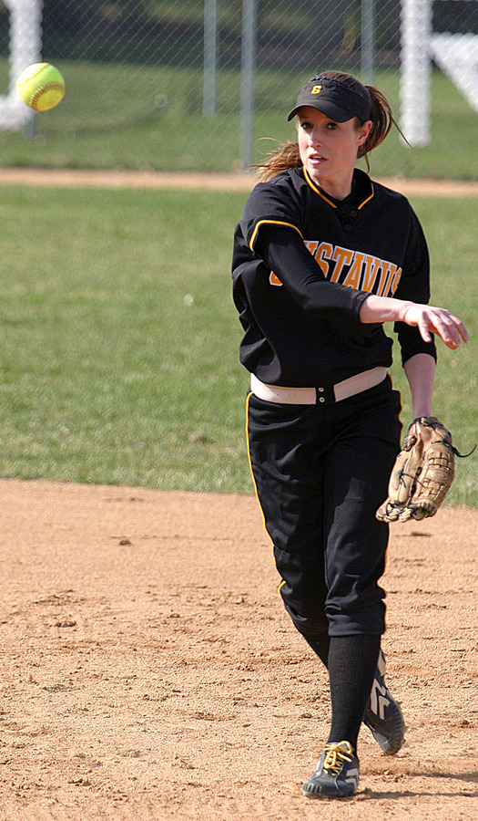 Julie Mahre throws to first base.