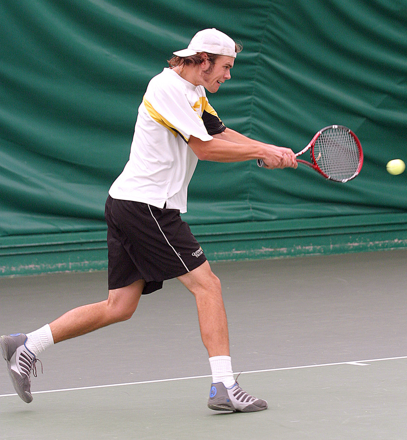 Nick Hansen rips a backhand in his doubles match.
