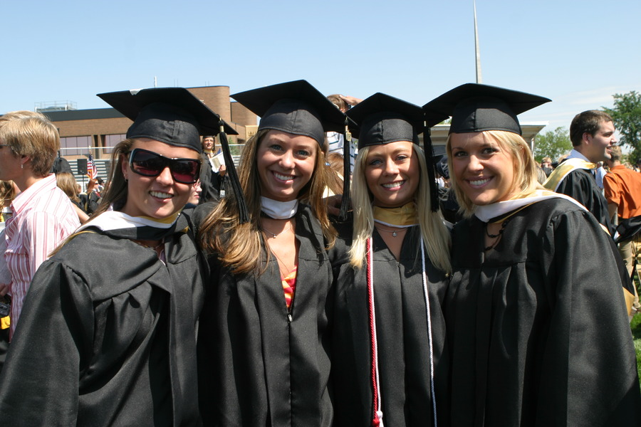 A group of 2007 graduates gather for a photo after last year's commencement ceremony.