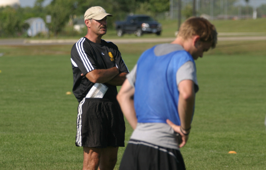 Coach Larry Zelenz watches practice