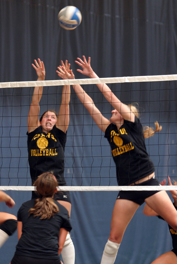 Senior Bridget Burtzel and junior Meghan Gehring go up for the block.