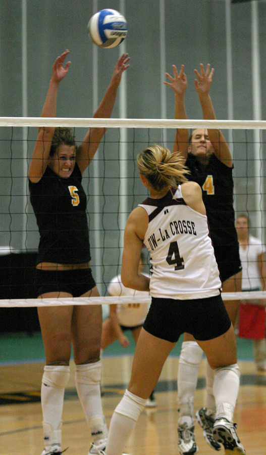 Britta Bolm and Angela Ahrendt go up for the block against UW-La Crosse.