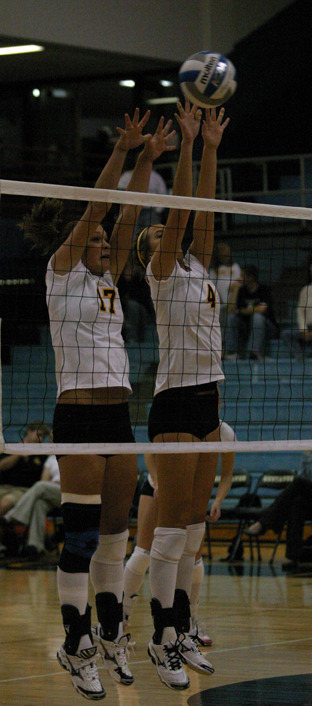 Abby Roff and Angela Ahrendt combine for the block.
