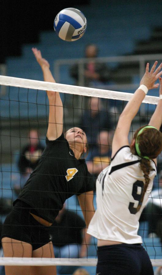 Angela Ahrendt goes up for a hit against Carleton's Megan La Chapelle.