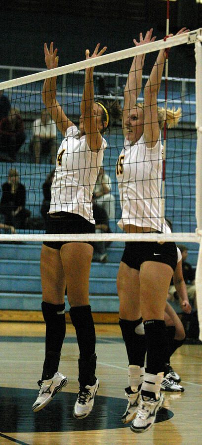 Angela Ahrendt and Olivia Warren go up for the block.