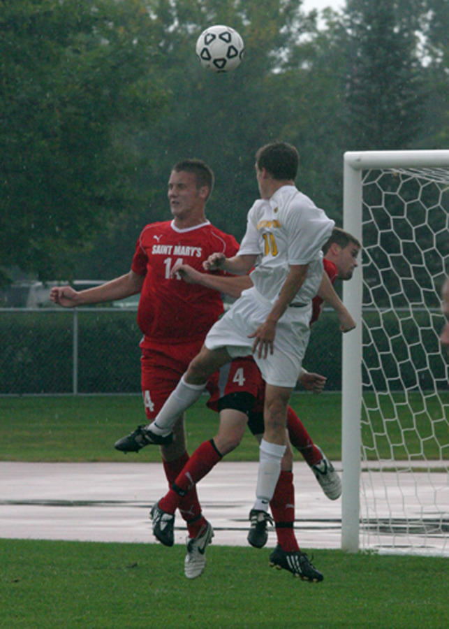 Bret VanderStreek goes high for a header in the box.