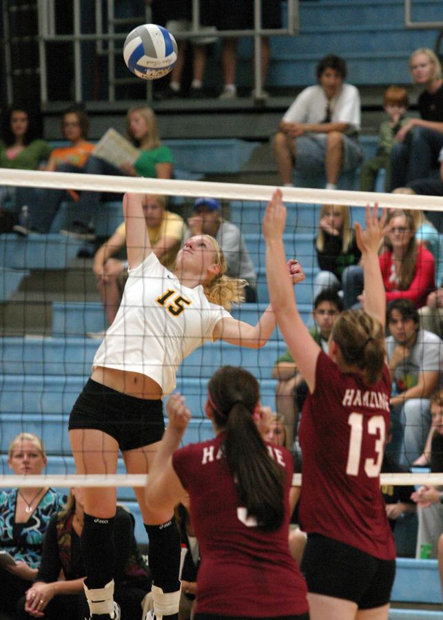 Olivia Warren hits over the Hamline block.