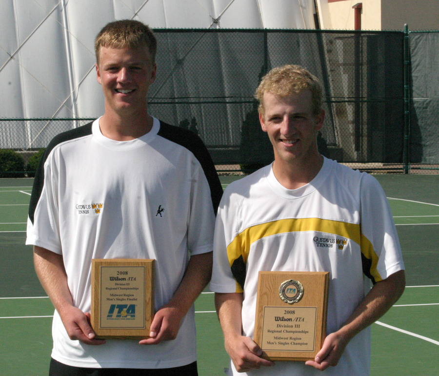 Charlie Paukert and John Kauss with their singles trophies.