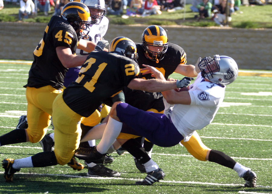 The Gustavus defense stops a St. Thomas player.