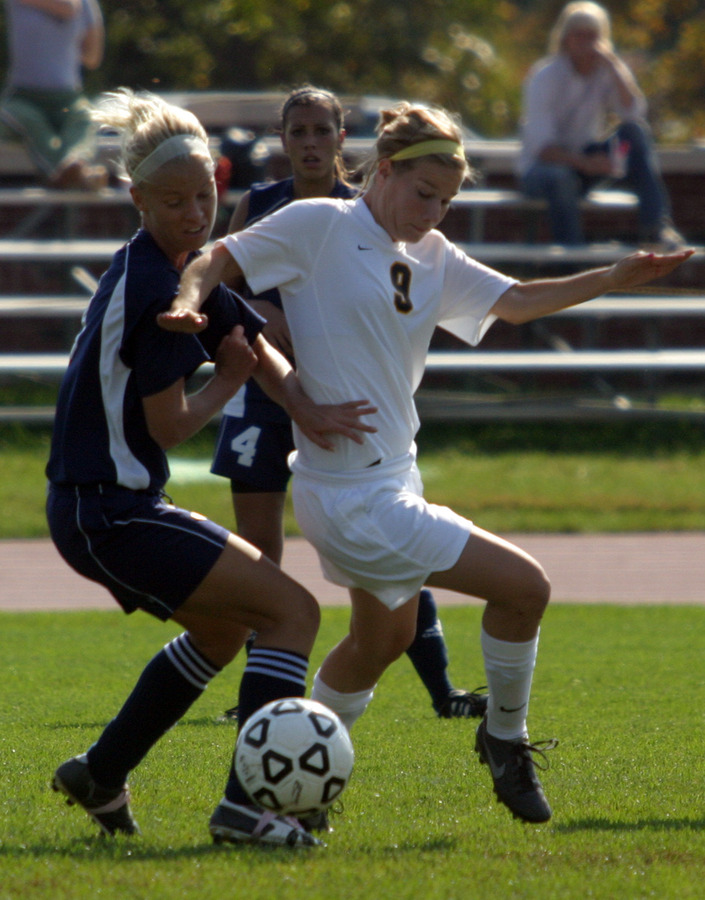Abbey Maus fights for control of the ball