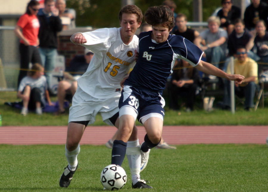 Fraser Horton battles for possession with a Bethel player.