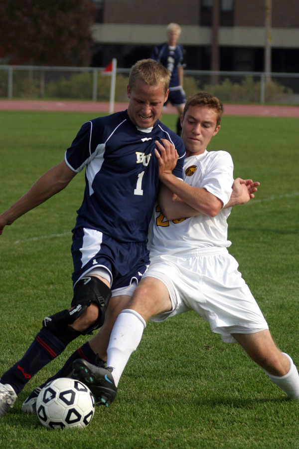 Mark Adams battles for possession.