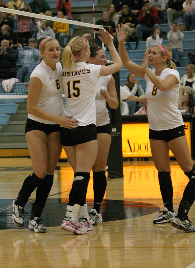 Olivia Warren is congratulated after putting down a kill.