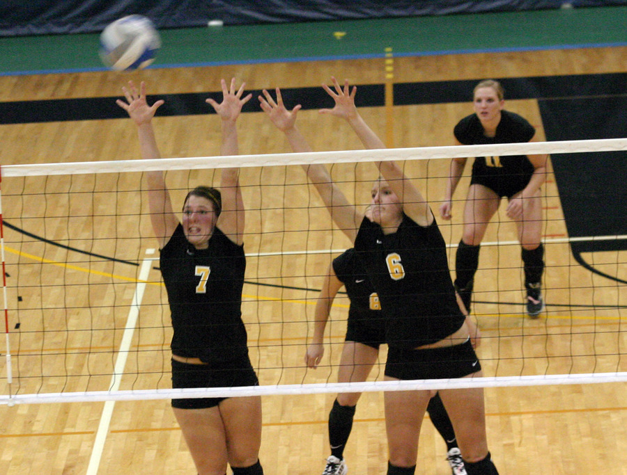 Bridget Burtzel and Meghan Gehring jump for the block.